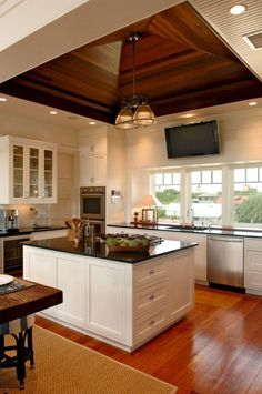 South Carolina barrier island home designed by Herlong and Associates. I love the floating ceiling detail in this fabulous kitchen. Scandinavian Modern, Beautiful Kitchens, Cool Kitchens, Ceiling Fan In Kitchen, Kitchen Ceilings, Home Interior, Interior Design, Wooden Ceilings, Vaulted Ceilings
