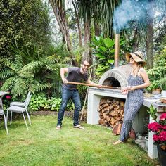 How amazing is this backyard setup? Mike made the pizza oven with help from his…