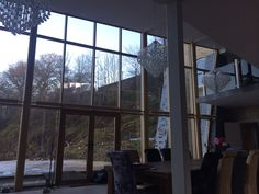 Three large chandeliers in my glass atrium joining two large building I've renovated