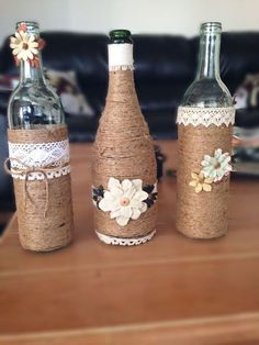 Dress up a glass bottle with string. Here is for you today a small selection of 20 ideas to d Wine Bottle Design, Wine Bottle Art, Diy Bottle, Empty Wine Bottles, Recycled Bottles, Bottles And Jars, Wedding Wine Bottles, Glass Bottle Crafts, Wine Craft