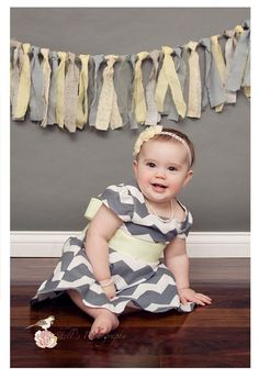 yellow and grey first birthday photos