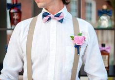 Such a cute look for your groom or his groomsmen - preppy with pink and navy bowtie, suspenders, and pretty pink bout. Florals by Cole Dewey Designs. Tabletop by Events by Morgan. Photo by Ely Fair Photography. #wedding #bowtie #groom #preppy