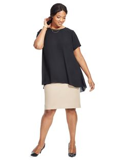 Hi-Low Hem Blouse In Black by Vince Camuto Available in sizes 1X-3X