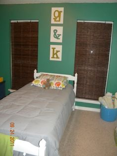 Kid's Room: Painted letters on canvas. Easy as pie & CHEAP ;)