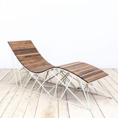 Uhuru Cyclone Lounger - in reclaimed Coney Island boardwalk (ipe) with powdercoated steel base.  Uhuru is a multi-disciplinary design firm based in Red Hook, Brooklyn with pieces in the Smithsonian and Brooklyn Museum's permanent collections.