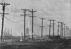 The Statue of Liberty as seen from Jersey City in 1973. Looks like some sci-fi dystopia. - Imgur