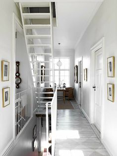 open stairs treads add light and visual space to a small hall area.