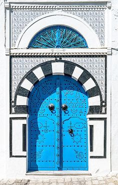 Blue Door with Black and White Trim. Sidi Bou Said, Tunisia. Sidi Bou Said is a small Tunisian city in which the exterior of nearly every building is done in these colors. Entrance Doors, Doorway, Old Doors, Windows And Doors, Art Du Monde, Door Gate, Unique Doors, Architectural Features, Closed Doors