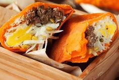 Ilocano Empanadas have savory fillings of green papaya, mung beans, and sometimes chopped longganisa (Ilocano sausage) and egg yolk. These ingredients are wrapped up in a thin rice flour wrapper, colored orange with achuete (annatto), and deep fried until crispy.