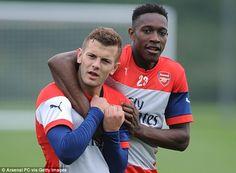 Danny Welbeck jokingly grabs Arsenal midfielder Jack Wilshere around the neck during Thurs...