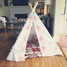 DIY teepee tent for a kid. Made with thrifted materials. Simple tutorial found here: http://thepapermama.com/2012/03/the-new-teepee.html