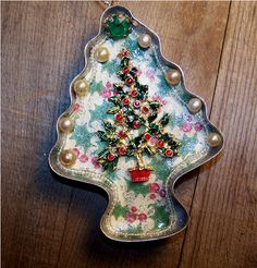 Christmas Tree Cookie Cutter Ornament Made from a Vintage Tree Cookie Cutter.  via Etsy.