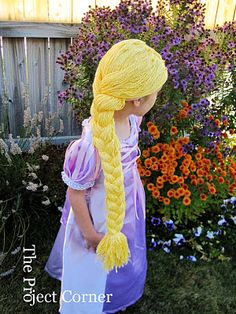 Making a Rapunzel wig...notes on construction : next time, lock up the cats before working with this much yarn.