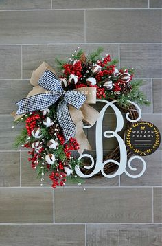 Adorn your home for the holidays with this Rustic Farmhouse Artificial Christmas Grapevine Wreath decorated with faux pine branches,pine cones, red berries, white pip berries, & fluffy off-white cotton balls. Its a perfect representation of the alluring scenery mother nature grants us,