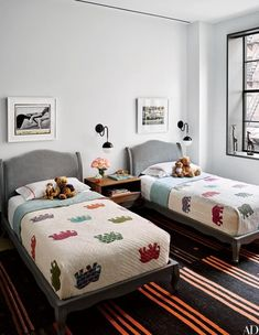 Images by Naomi Watts's brother, photographer Ben Watts, are displayed above RH Baby & Child beds in the boys' room of her Manhattan apartment, which was decorated by Ashe + Leandro | archdigest.com