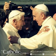 Pope Benedict XVI and Pope Francis greet in 2014.