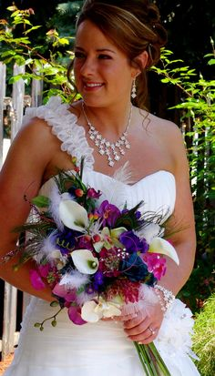 Peacock Wedding Flowers Couture Designed Bridal Bouquet Fuschia Teal Purple silk Orchids Callas wedding accessories. $269.00, via Etsy.  Incorporating feathers in bouquets and floral arrangements - even full feather centerpieces - is going to be a popular trend this year.