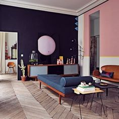 Wood chevron floors. Pink and ink walls.