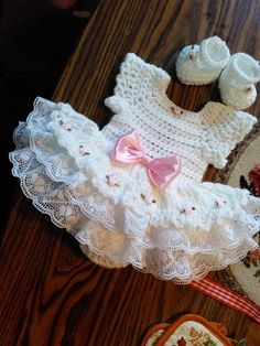 White crochet Rosebud onsie baby dress set.