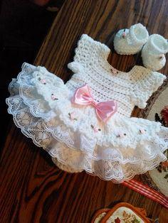 White crochet Rosebud onsie baby dress set.