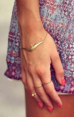 Jewelry. Accessories. Rings. Bracelet. Neon orange nails.