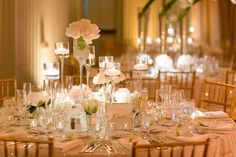 Love the volume on the table: no one big center piece but few little touches of different flowers in those silver vases. Nice change from the traditional one piece centerpiece