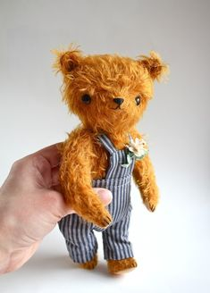 small mohair bear with overalls