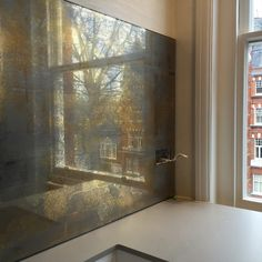 22 carat moon and white gold textured panels for calm kitchen in Chelsea