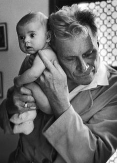 In lieu of stethoscope, French Dr. Albert-André Nast, who is blind, holds his ear to the back of a 3-mo old, c. 1953. (Thomas McAvoy, Time Life Pictures/Getty Images)