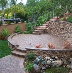 Great Landscape Ideas For Sloping Backyard Retaining Walls On A Slope Retaining Wall Ideas For Sloped - Yard Landscaping is actually extremely important as Sloped Backyard Landscaping, Backyard Retaining Walls, Retaining Wall Design, Sloped Yard, Stone Retaining Wall, Fire Pit Backyard, Backyard Patio, Landscaping Ideas, Sloping Backyard