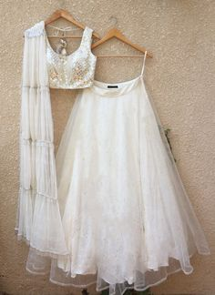 Buy White Color Lehenga by Akanksha Singh at Fresh Look Fashion Indian Wedding Gowns, Indian Gowns Dresses, Indian Fashion Dresses, Dress Indian Style, Indian Designer Outfits, Indian Outfits, Gown Wedding, Designer Clothing, Indian Lehenga