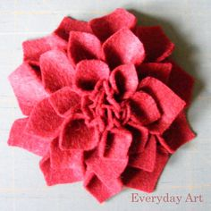 Gorgeous... Yes. Cheep... Yes. Easy... of Course! Want to make one?  Start by cutting 3 sizes of felt squares. I cut 12 of largest, 10 of...