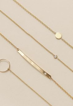 Simple everyday gold bracelets by Vrai & Oro.