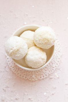 boules de neige   carnets parisiens - two meringues sandwiched together with coconut ganache and rolled in coconut