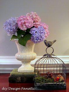 Love hydrangeas, love birdcages.