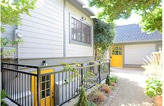 An egress door instead of an egress window? Wouldn't work on the driveway side. Emerick Architects, Portland, OR