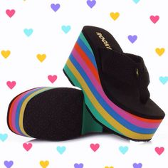 YES these colorful striped chunky platform sandals are a MUST have!!! Show off your vibrant 90s personality in these Big Top sandals by Rocket Dog.