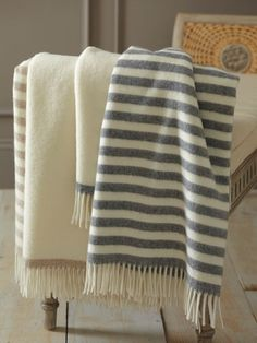 Mix and match these neutral-hued Lorenzo Wool Throws. $158 each from Garnet Hill.