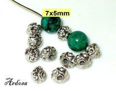 10 Perlen Rhomben 7x5mm silber  103.7.12 von Schmuckmaterial