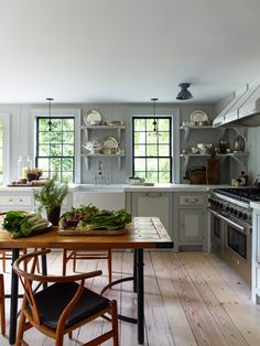 Steven Gambrel's Newest Sag Harbor Project 2015 • on @SavvyHome | Light blue/gray and white. Range. Farmhouse sink.