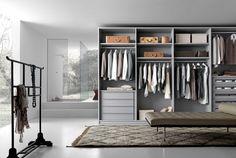 Interior accessories with drawer packs, shelves and structure in clay oak melamine.__ Attrezzatura interna con cassettiere, ripiani e struttura in melaminico rovere argilla.