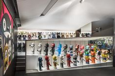 "Welcome to the ""Bear Garage,"" where over 70 of the rarest Bearbricks are kept safe and sound. The space was completed in two phases spanning three years by Thailand's Onion Studio, who have used a mix of aluminum and carbon fiber sheets to create this stunning garage, which houses 51 1000% Bearbricks, two 400% Bearbricks, and a large KAWS sculpture."