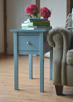 Not the right color but the slimness would work and I love the modern style of this side table!