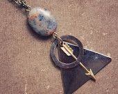 cosmo.  a geometric arrow and astral bead necklace.