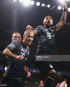 Arjen Robben of Bayern Muenchen (C) celebrates as he scores their second goal with team mates Arturo Vidal (R) and Franck Ribery (L) during the UEFA Champions League Round of 16 second leg match between Arsenal FC and FC Bayern Muenchen at Emirates Stadium on March 7, 2017 in London, United Kingdom.