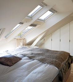 Love the skylights above the bed.