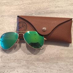 SOLD! ‼️‼️Rayban 55MM Bright Green Flash Mirrored Rayban 55MM Bright Green Flash Mirrored Lenses with case. Bought from a previous posher, but never worn. Previous posher said she only wore for a month. They have just been sitting in the case. They are in great condition. Had them authenticated. They are authentic. Comes with brown case, box, and cleaning cloth. These are 55MM, they were previously listed as 58, but they are actually 55 mm!  not polarized! Ray-Ban Accessories Sunglasses