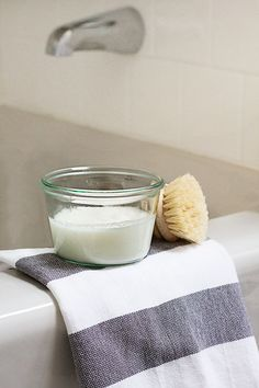 Banish soap scum without the harsh chemicals with this DIY bathtub scrub, made with castile soap, baking soda, salt, washing soda, and essential oil.