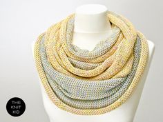 Hey, I found this really awesome Etsy listing at http://www.etsy.com/listing/93585454/knitted-loop-snood-scarf-pastel-colorful
