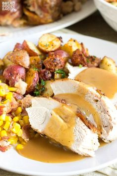 Thanksgiving dinner plate with sides and turkey that has easy turkey gravy poured over the top